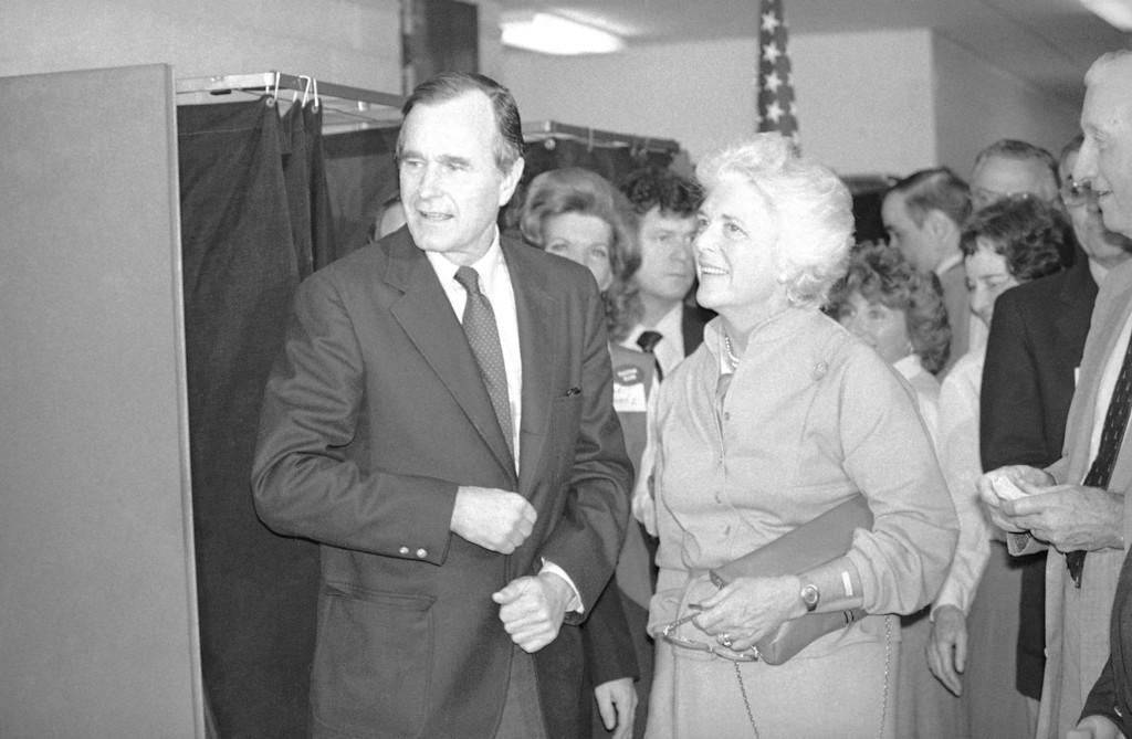 . Republican vice-Presidential candidate and wife, Barbara are all smiles after casting their vote in the general election at their Houston precinct, Tuesday, Nov. 4, 1980. Bush was happy over the heavy turnout of voters at his precinct. (AP Photo)