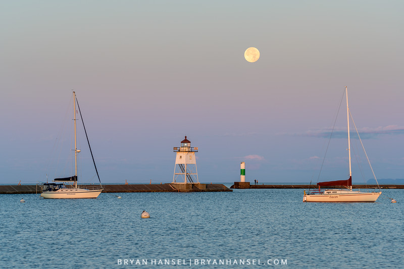 Sturgeon Moon Setting over Grand Marais' Lighthouse