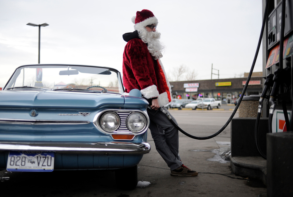 . Marc Quinlan, 30, dressed as Santa Claus fuels up at a 7-11 on Broadway on Wednesday, December 21, 2011. AAron Ontiveroz, The Denver Post