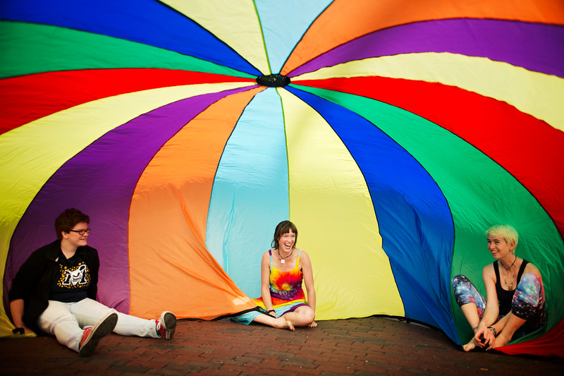 Students from the 'Good Vibes' organization play games with a parachute by Centennial Common at Northeastern University on Sept. 28, 2015.
