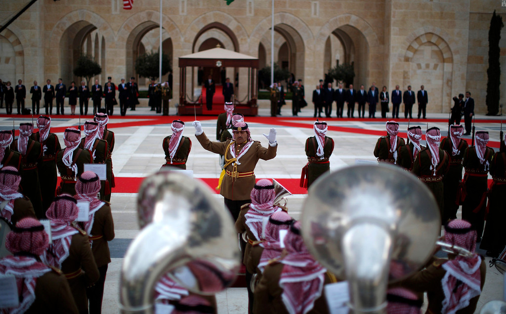 . A band plays national anthems as U.S. President Barack Obama (background) participates in an official arrival ceremony with Jordan\'s King Abdullah II at Al-Hummar Palace, in Amman March 22, 2013. REUTERS/Jason Reed