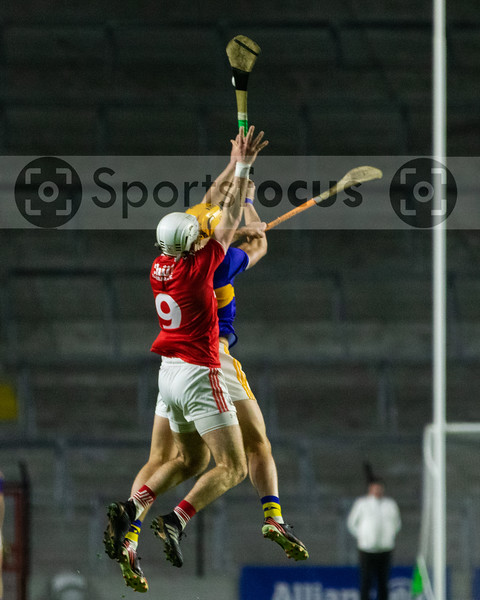 Cork's Luke Meade and Tipperary's Ronan Maher contest a high ball