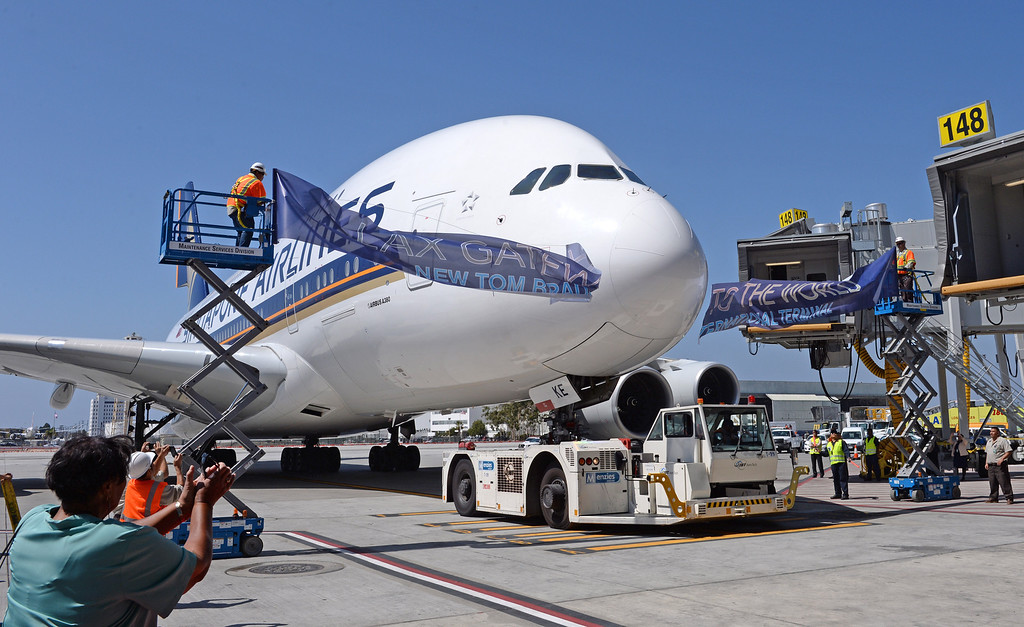 . Singapore Airlines Airbus 380 breaks the ribbon to officially open the new Tom Bradley International Terminal (TBIT) at LAX. Lorraine Bradley in far left corner. (Wed. Sept 18, 2013 Photo by Brad Graverson/The Daily Breeze