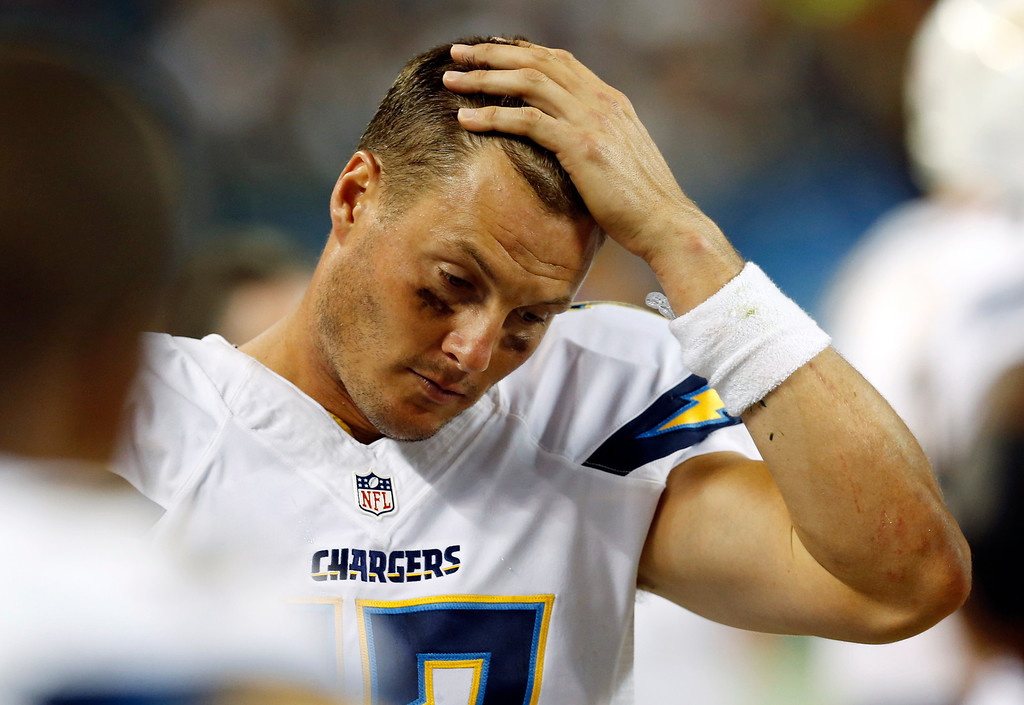 . San Diego Chargers quarterback Philip Rivers (17) reacts on the sideline during the first half of the preseason NFL football game against the Chicago Bears, Thursday, Aug. 15, 2013, in Chicago. (AP Photo/Charles Rex Arbogast)