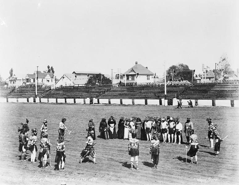 "Men performing the ""Ta-ta-Wheela"" Indian Dance at Fiesta Park during La Fiesta de Los Angeles, ca.1897"
