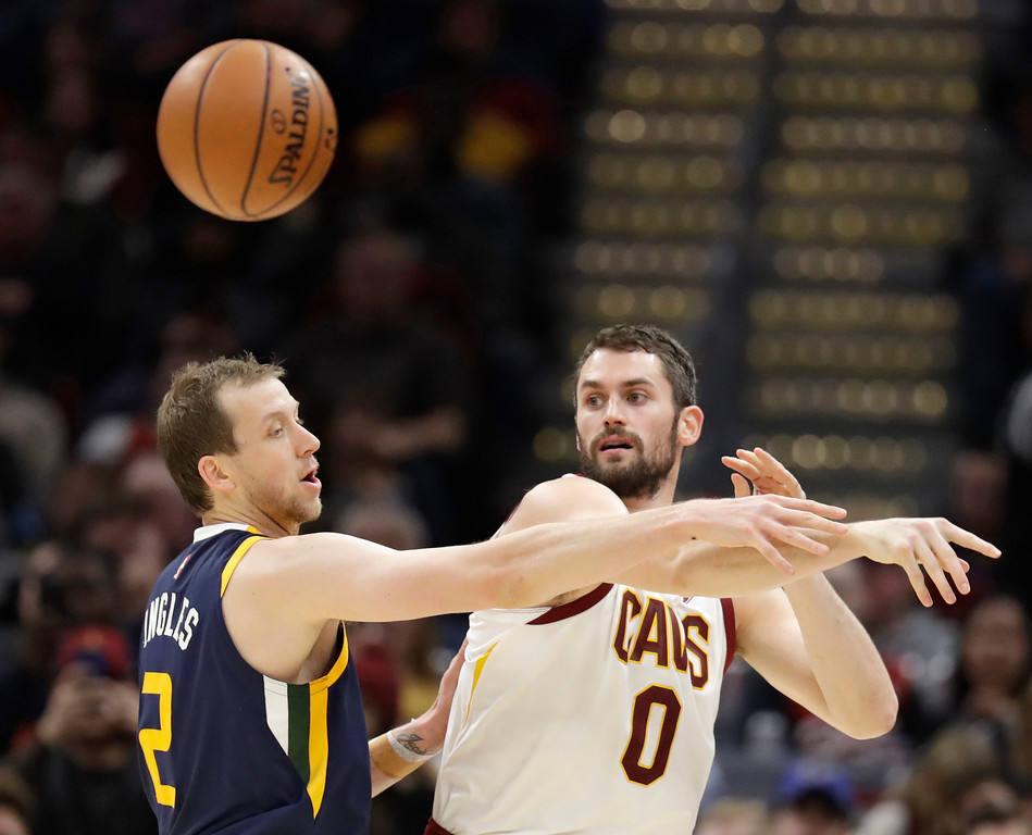 . Cleveland Cavaliers\' Kevin Love (0) passes against Utah Jazz\'s Joe Ingles (2), from Australia, in the first half of an NBA basketball game, Saturday, Dec. 16, 2017, in Cleveland. (AP Photo/Tony Dejak)