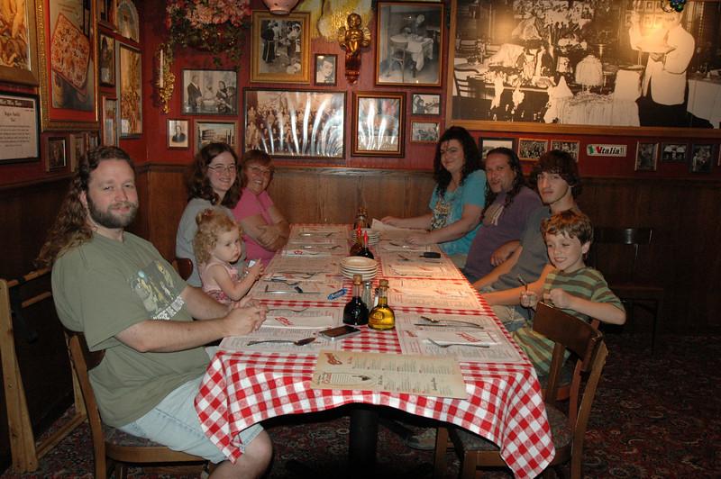 Eric, Beverly, Deb, Kathy, Rachel, Matt, Jamie, and Gillian having dinner at Buca de Beppo