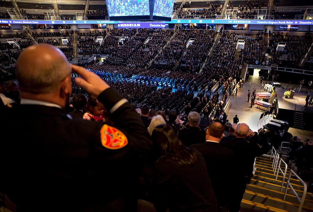 . Thousands of supporters, police officers, and firefighters stood and saluted the caskets holding Santa Cruz Police detective Sgt. Loran \'Butch;\' Baker and detective Elizabeth Butler. (Kevin Johnson/Sentinel)