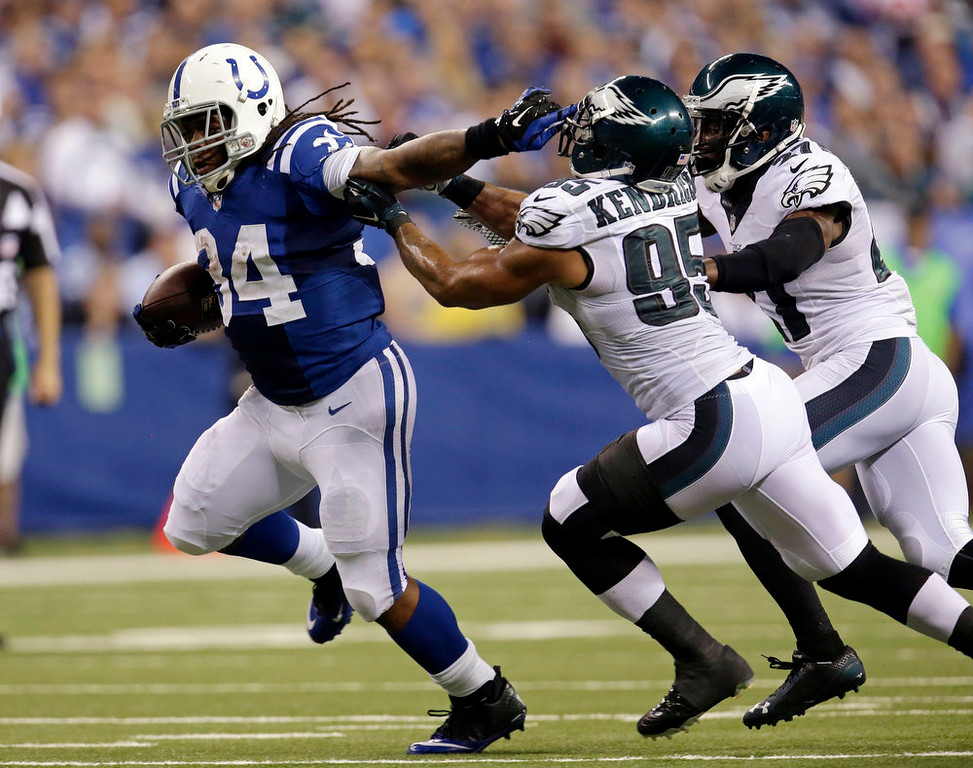 . Indianapolis Colts running back Trent Richardson (34) runs past Philadelphia Eagles inside linebacker Mychal Kendricks (95) during the first half of an NFL football game Monday, Sept. 15, 2014, in Indianapolis. (AP Photo/AJ Mast)