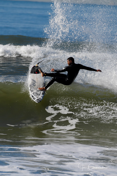 Surfers at Hunting Beach Pier