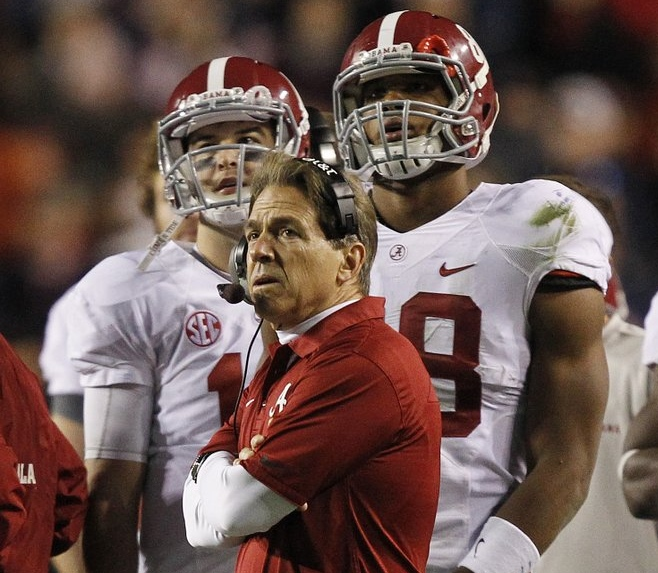 """. <p><b> Alabama�s dreams of a third consecutive national championship suffered a crippling blow Saturday when coach Nick Saban decided to do this in the fourth quarter of the Iron Bowl � </b> <p> A. Try a 57-yard field goal with a new kicker <p> B. Gamble on several fourth downs <p> C. Drink heavily <p><b><a href=\'http://www.twincities.com/sports/ci_24633078/iron-bowl-alabama-auburn-thriller-will-take-while\' target=\""""_blank\"""">HUH?</a></b> <p>    (AP Photo/Butch Dill)"""