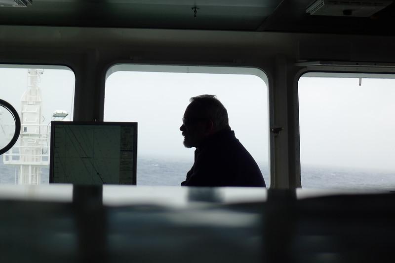 Antarctica - Jan 2013 - Sergey Vavilov Circle Trip,  The Vavilov's Captain in silhouette, on the bridge, Jan 2013.