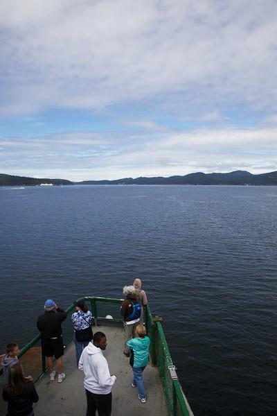Passengers on Washington State Ferry bow observation deck. San Juan Islands, Washington.