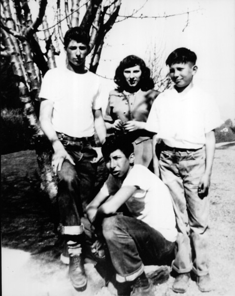 Angelo, Lorraine, Bob, and Buck in the front. Mid 1940s.
