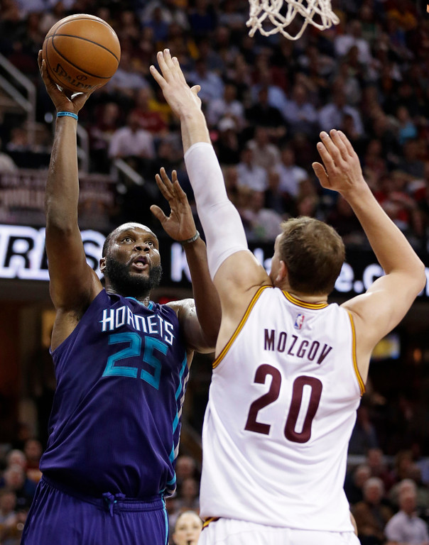 . Charlotte Hornets\' Al Jefferson (25) shoots against Cleveland Cavaliers\' Timofey Mozgov (20), from Russia, in the second half of an NBA basketball game Wednesday, Feb. 24, 2016, in Cleveland. The Cavaliers won 114-103. (AP Photo/Tony Dejak)