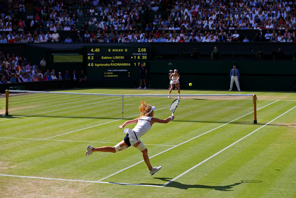 . LONDON, ENGLAND - JULY 04:  Agnieszka Radwanska of Poland hits a forehand during the Ladies� Singles semi final match against Sabine Lisicki of Germany on day ten of the Wimbledon Lawn Tennis Championships at the All England Lawn Tennis and Croquet Club on July 4, 2013 in London, England.  (Photo by Julian Finney/Getty Images)