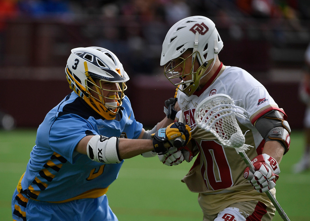. Denver Pioneers Colton Jackson #10 battles with Marquette Golden Eagles Griffin Connor #3 in the third quarter during the Big East Championship game at Peter Barton Stadium May 07, 2016. (Photo by Andy Cross/The Denver Post)