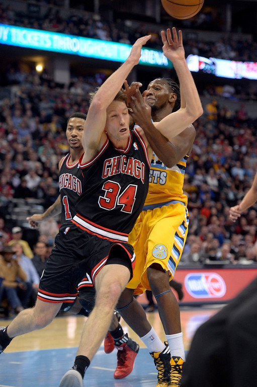 . Denver Nuggets power forward Kenneth Faried (35) and Chicago Bulls small forward Mike Dunleavy (34) collide as they go after a pass during the first quarter November 21, 2013 at Pepsi Center. (Photo by John Leyba/The Denver Post)
