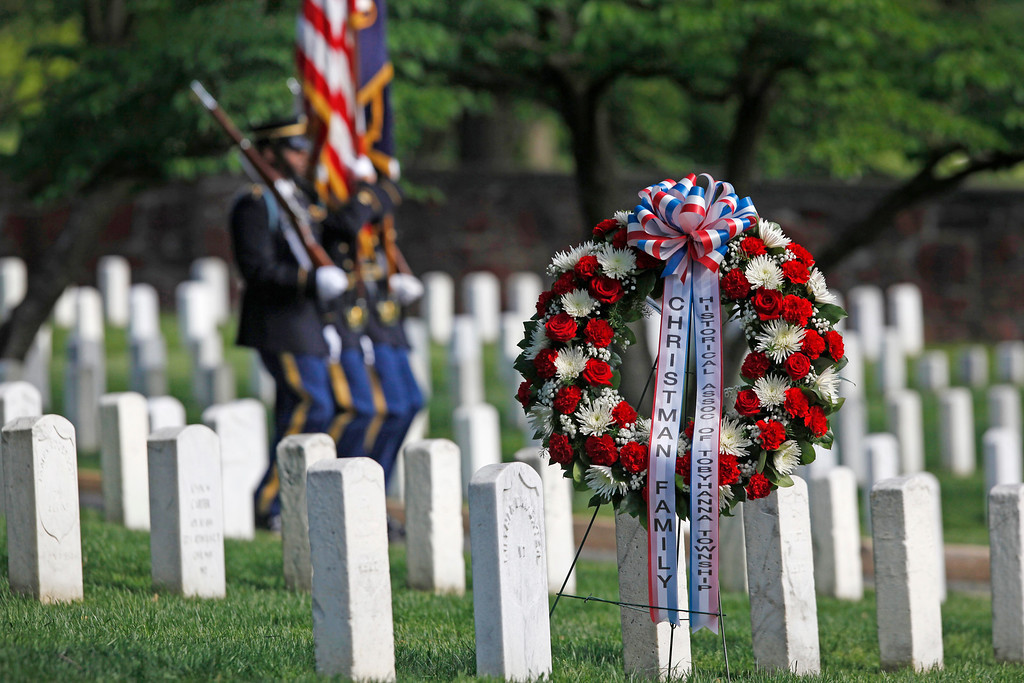 . U.S. Army honor guard arrive before the wreath laying at the gravesite of Army Pvt. William Christman, who was the first military burial at the cemetery, marking the beginning of commemorations of the 150th anniversary of Arlington National Cemetery in Arlington, Va., Tuesday, May 13, 2014. (AP Photo)