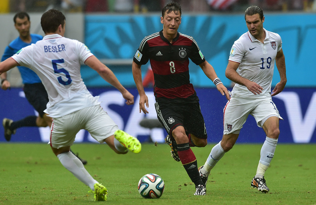 . Germany\'s midfielder Mesut Ozil (C), US defender Matt Besler (L) and US midfielder Graham Zusi (R) vie for the ball during a Group G football match between US and Germany at the Pernambuco Arena in Recife during the 2014 FIFA World Cup on June 26, 2014. NELSON ALMEIDA/AFP/Getty Images