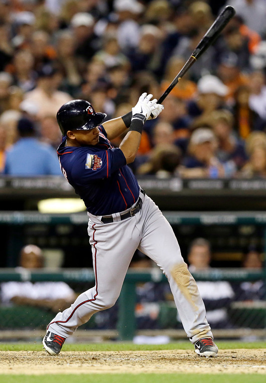 . Minnesota Twins\' Eduardo Escobar connects for a single to center field to score teammate Joe Mauer during the seventh inning of a baseball game against the Detroit Tigers in Detroit, Saturday, Sept. 27, 2014. (AP Photo/Carlos Osorio)