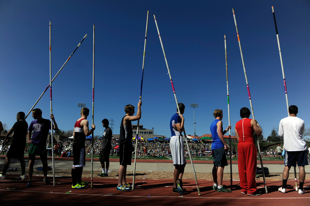 . LITTLETON, CO. - APRIL 27TH: High School pole vaulters line up for warm-ups before the Liberty Bell Track Meet at Littleton Public Schools Stadium Saturday, April 27th, 2013. (Photo By Andy Cross/The Denver Post)