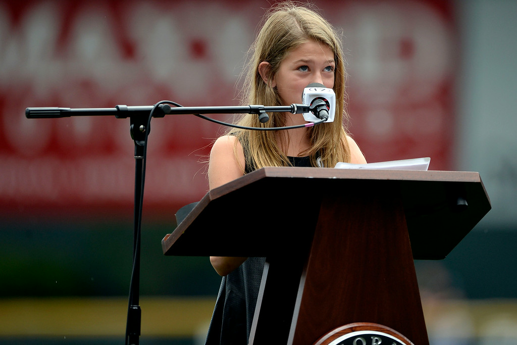 . Colorado Rockies great Todd Helton\'s daughter, Tierney Faith gives a speech honoring her father during a retirement ceremony for his number 17. Helton, who played 17 season with the Rockies and holds records for many of the organizations career statistics, was honored on Sunday, August 17, 2014. (Photo by AAron Ontiveroz/The Denver Post)
