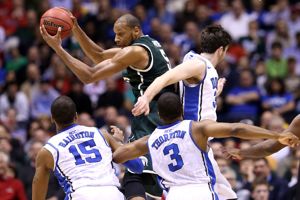 . Adreian Payne #5 of the Michigan State Spartans controls a rebound against Josh Hairston #15, Tyler Thornton #3 and Ryan Kelly #34 of the Duke Blue Devils during the Midwest Region Semifinal round of the 2013 NCAA Men\'s Basketball Tournament at Lucas Oil Stadium on March 29, 2013 in Indianapolis, Indiana.  (Photo by Streeter Lecka/Getty Images)