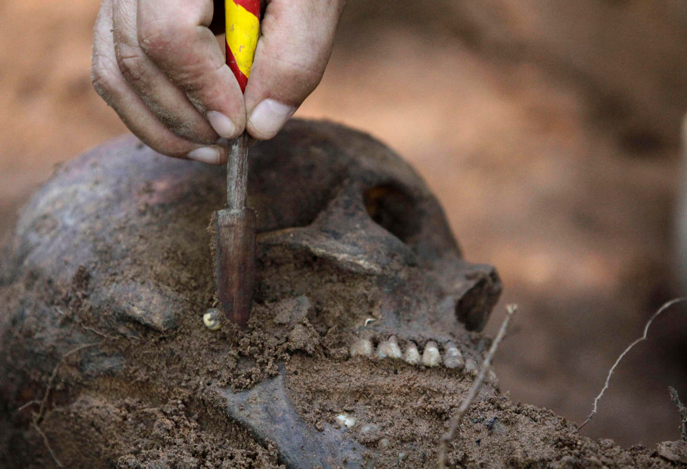 Description of . Human remains discovered in the grounds of a police barracks in Asuncion, Paraguay on March 21, 2013. According to the researchers, 15 more skeleton remains, likely to be victims of the 1954 to 1989 dictatorship under Alfredo Stroessner, were found in the last two days.  REUTERS/Jorge Adorno