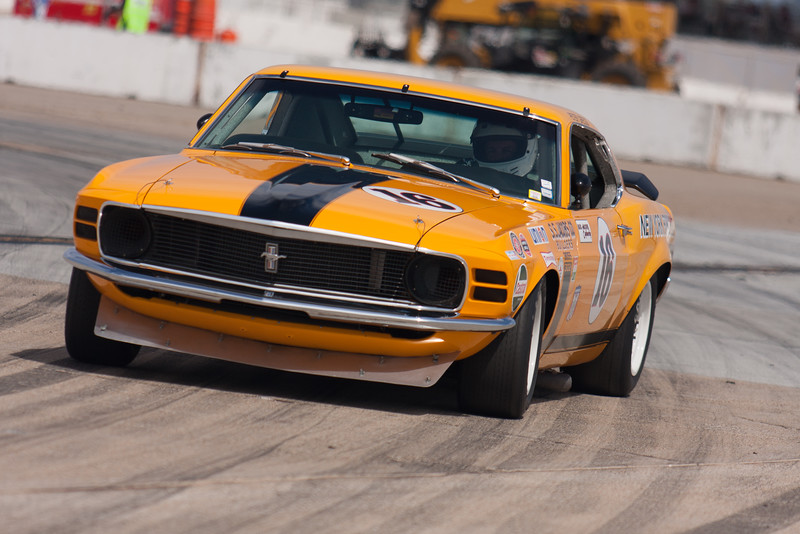 Jim Hague power slides his 1970 Ford Boss 302 Mustang out of turn 11. © 2014 Victor Varela