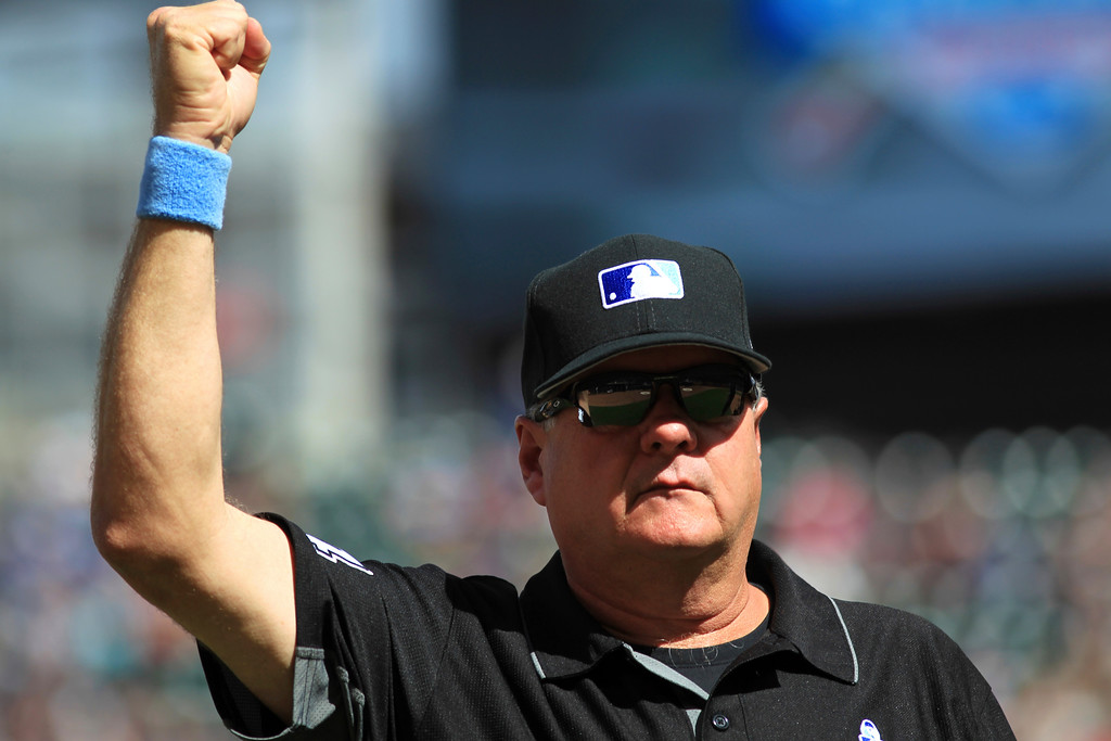 . Umpire Jerry Layne calls the last out on a review of Cleveland Indians pitcher Andrew Miller narrowly tagging out Minnesota Twins\' Eddie Rosario at first to end a baseball game in the ninth inning Sunday, June 18, 2017, in Minneapolis. (AP Photo/Andy Clayton-King)
