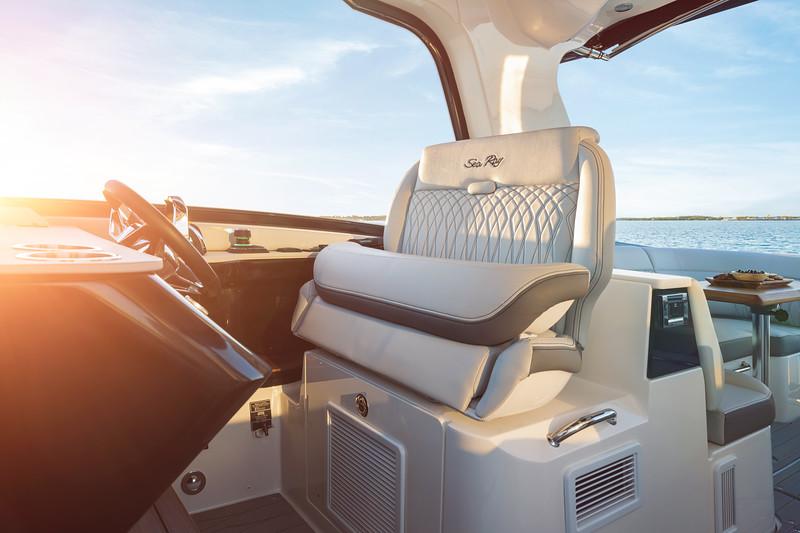 2021-Sundancer-370-Outboard-DAO370-helm-seat-bolster-up-sunset-05187.jpg