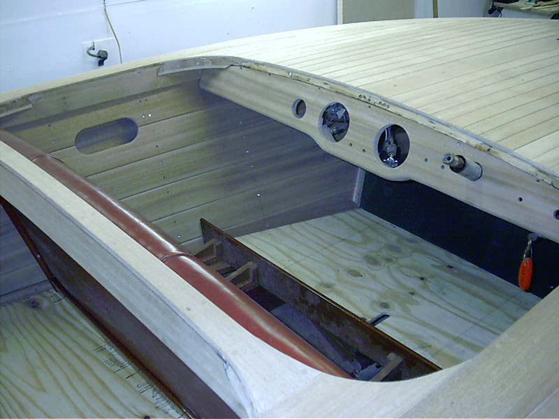 Port side mahogany cockpit liner with new seat frames and floor.
