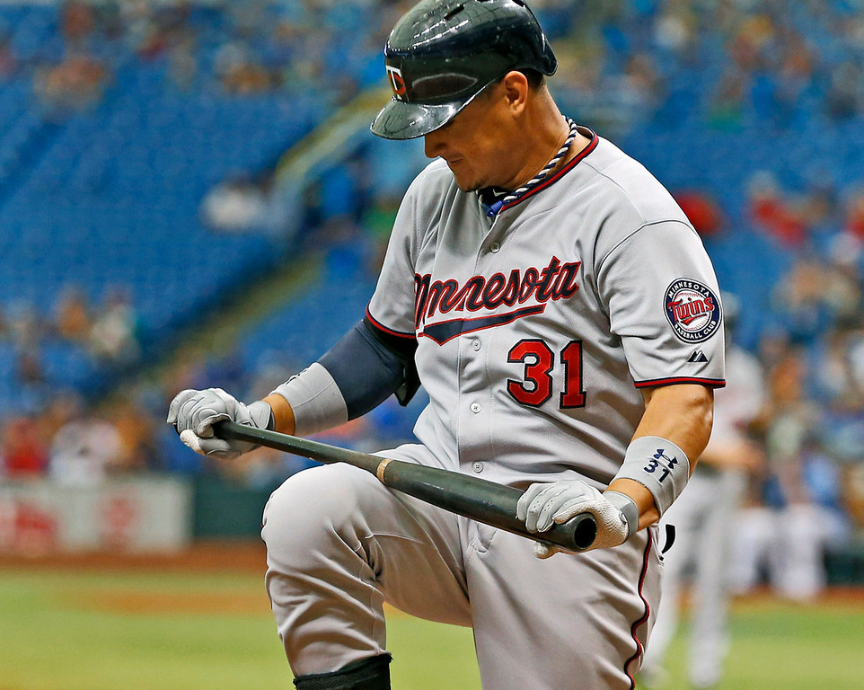 . Minnesota\'s Oswaldo Arcia reacts after striking out during the ninth inning against the Rays. (AP Photo/Mike Carlson)