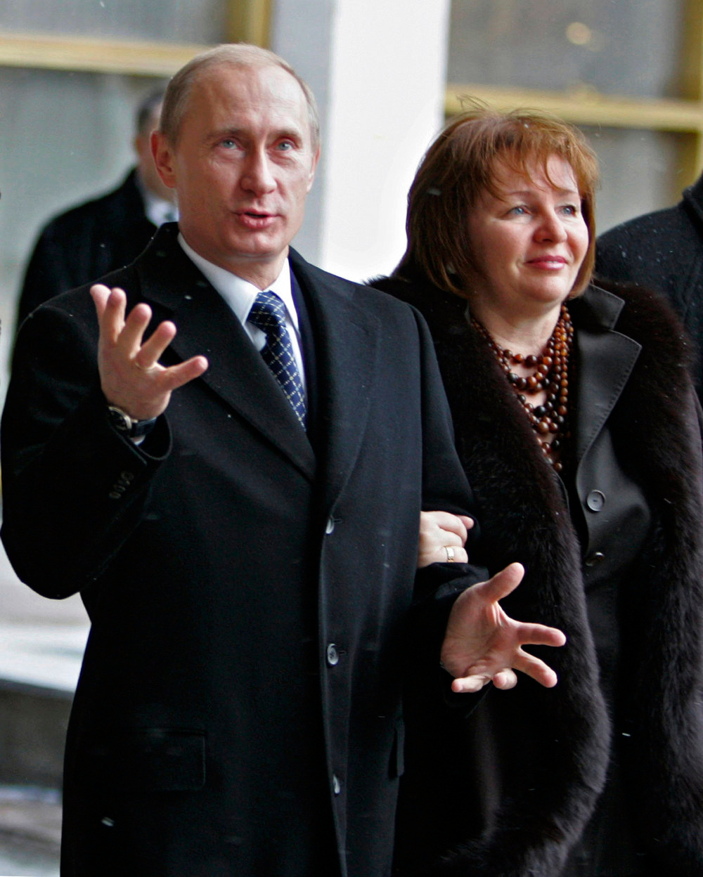 . Russian President Vladimir Putin, left, and his wife Lyudmila, right, stand at a polling station in Moscow, Russia, Sunday, Dec. 2, 2007.  Millions of Russians cast ballots in parliamentary elections Sunday, in a tense vote that followed a campaign marked by intimidation, manipulation and arrests designed to ensure a major victory for President Vladimir Putin\'s party. (AP Photo/RIA-Novosti, Dmitry Astakhov, Presidential Press Service)