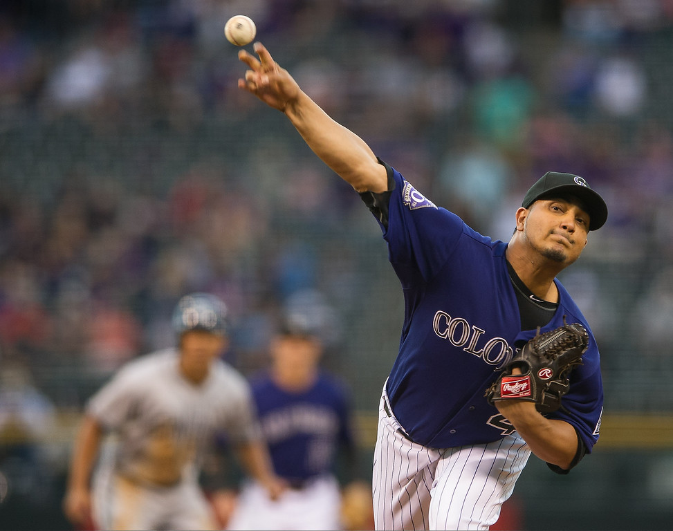 . Jhoulys Chacin #45 of the Colorado Rockies delivers a pitch against the San Diego Padres in the first inning of a game at Coors Field on August 12, 2013 in Denver, Colorado. The Rockies led the Padres 2-0 after one inning.  (Photo by Dustin Bradford/Getty Images)