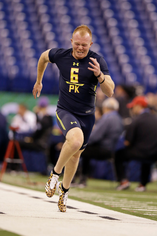 . Ohio State punter Cameron Johnston runs the 40-yard dash at the NFL football scouting combine in Indianapolis, Friday, March 3, 2017. (AP Photo/Michael Conroy)