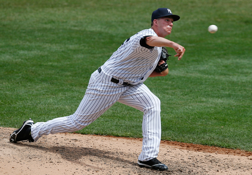 . New York Yankees relief pitcher Danny Burawa delivers in the sixth inning of a baseball game against the Detroit Tigers at Yankee Stadium in New York, Sunday, June 21, 2015. Burawa allowed four runs on three hits, including a three-run, home run in two-thirds of an inning. (AP Photo/Kathy Willens)