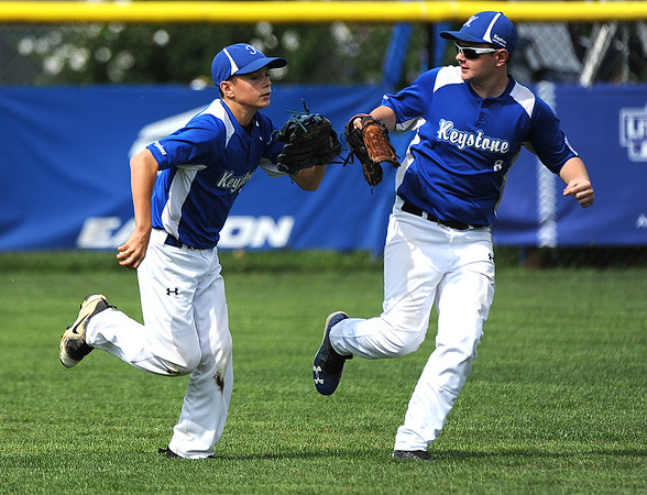 8/6/2018 Mike Orazzi   Staff' Keystone Little League's Connor Foltz (20) and Dallas Alexander (8) during a loss to Mid Island New York during the 2018 Little League Eastern Regional Tournament at Breen Field in Bristol Monday morning.