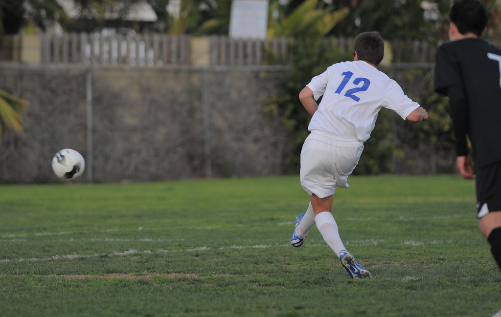 . 02-15-2012--(LANG Staff Photo by Sean Hiller)- Los Alamitos beat Buena 4-1 in the first round of the Division 1 boys soccer playoffs Friday at Laurel School in Los Alamitos. Daniel Weis makes scores a goal on a penalty kick.