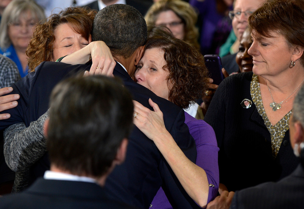 . DENVER, CO. - APRIL 03: President Barack Obama embraces Siblings (l-r) Sue Connors and Jane Dougherty following a forum at the Denver Police Academy in Denver, CO April 03, 2013. The siblings sister, Mary Sherlach, was killed at  Sandy Hook Elementary. In his first trip to Colorado since his re-election, President Obama urged Congress to act more like the state\'s Democratic-controlled legislature and quickly pass stronger gun-control laws. During the meeting with law enforcement officials and community leaders, Obama praised lawmakers and Gov. John Hickenlooper for passing some of the nation\'s strongest gun-control measures after the shootings in Aurora and at a Connecticut elementary school. (Photo By Craig F. Walker/The Denver Post)