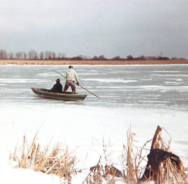 Dad Punting his Boat across the Ice.JPG