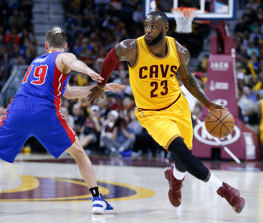 . Cleveland Cavaliers\' LeBron James (23) drives around Detroit Pistons\' Beno Udrih (19) during the first half of an NBA basketball game Friday, Nov. 18, 2016, in Cleveland. The Cavaliers won 104-81. (AP Photo/Ron Schwane)