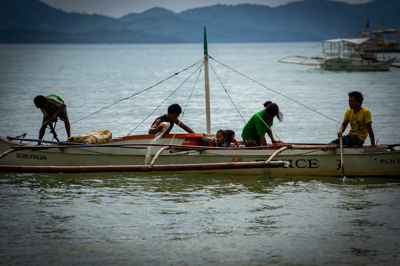 This family in El Nido wakes up early in the morning to beat the rush of tourists to fish for their restaurant.