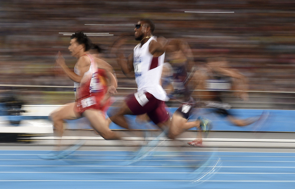. Qatar\'s Samuel Adelebari Francis (C) and Japan\'s Ryota Yamagata (L) compete in the semi-finals of the men\'s 100m athletics event during the 17th Asian Games at the Incheon Asiad Main Stadium in Incheon on September 28, 2014.  MARTIN BUREAU/AFP/Getty Images