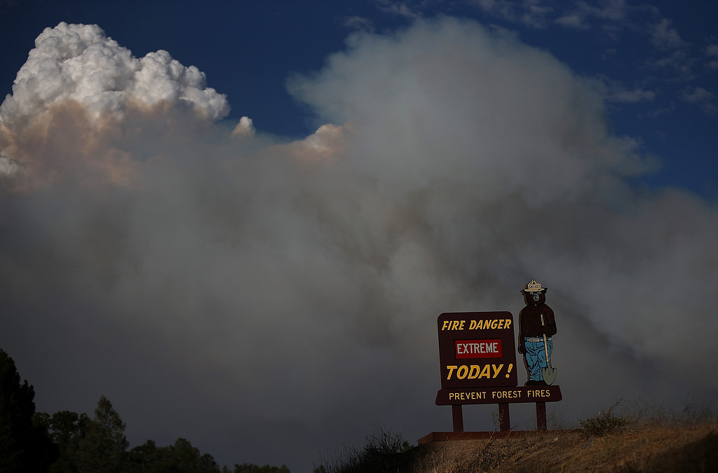 . GROVELAND, CA - AUGUST 21:  A Smokey the Bear sigb is posted along US highway 120 as the Rim Fire burns out of control on August 21, 2013 in Groveland, California. The Rim Fire continues to burn out of control and threatens 2,500 homes outside of Yosemite National Park. Over 400 firefighters are battling the blaze that is only 5 percent contained.  (Photo by Justin Sullivan/Getty Images)