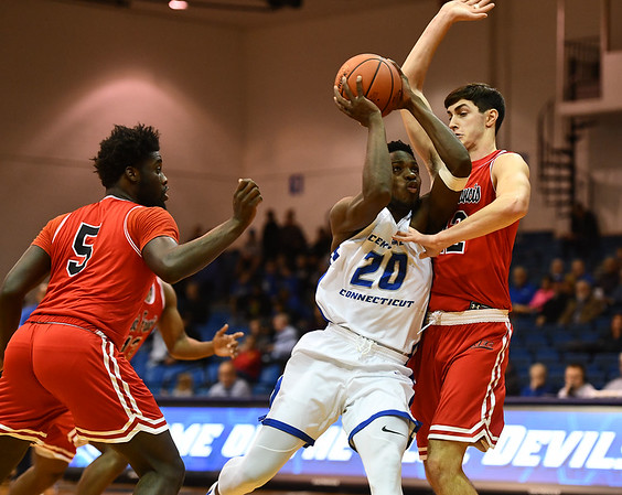 1/4/2020 Mike Orazzi | StaffrCentral Connecticut State University's Stephane Ayangma (20) and Saint Francis University's Mark Flagg (42) during Saturdays mens basketball game in New Britain.