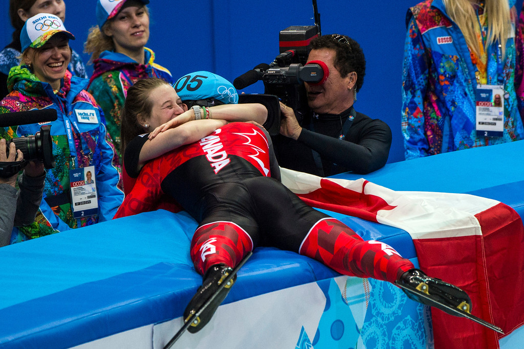 . Charles Hamelin, of Canada, hugs Marianne St-Gelais after winning in the 1,500-meter short-track speedskating finals at Iceberg Skating Palace during the 2014 Sochi Olympic Games Monday February 10, 2014. (Photo by Chris Detrick/The Salt Lake Tribune)