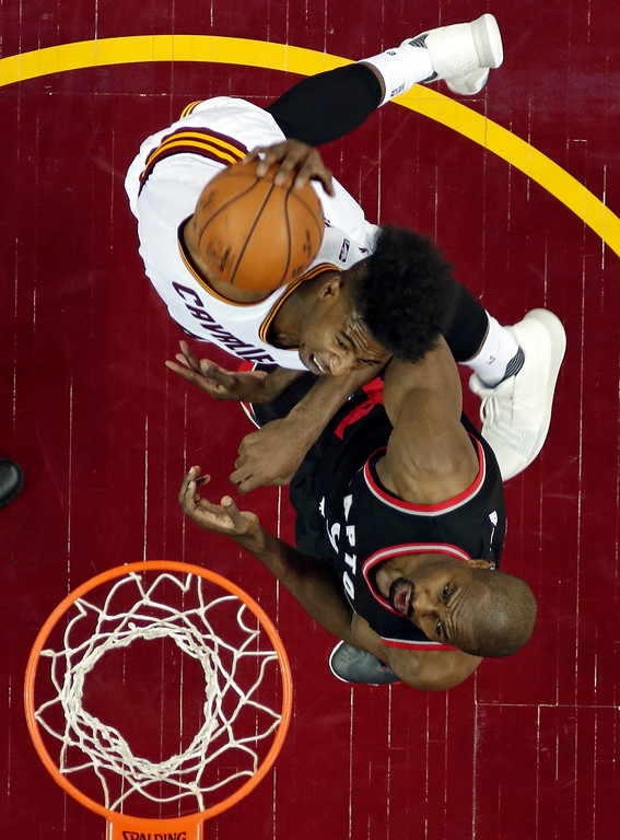 . Cleveland Cavaliers\' Iman Shumpert, top, dunks against Toronto Raptors\' Serge Ibaka, from Congo, in the first half in Game 1 of a second-round NBA basketball playoff series, Monday, May 1, 2017, in Cleveland. The Cavaliers won 116-105. (AP Photo/Tony Dejak)
