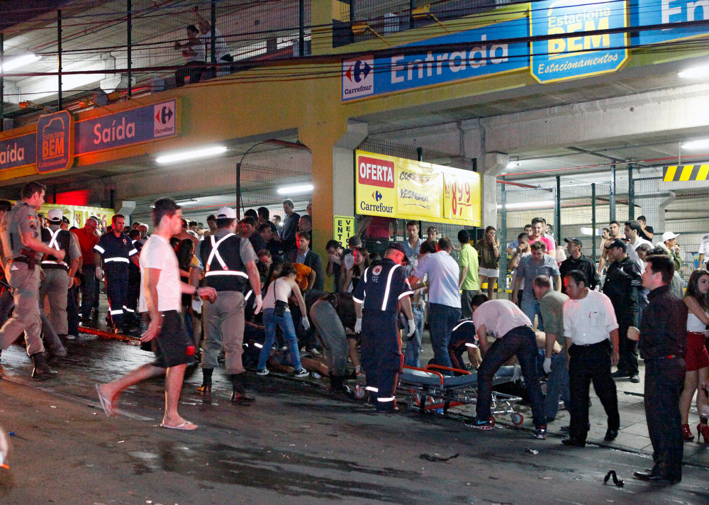 . The victims of a nightclub fire receive medical assistance in a street of Santa Maria, 550 Km from Porto Alegre, southern Brazil on January 27, 2012. The death toll climbed to 150 early Sunday as firefighters searched the charred remains of the establishment, television Globo reported.  Germano Roratto/AFP/Getty Images